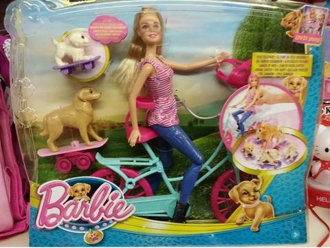 Bambola di barbie bicicletta