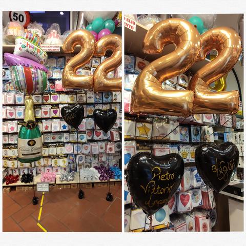 Decorazione di palloncini oro e nero per compleanno