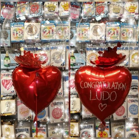 Decorazione di palloncini bubble e cuore con glitter