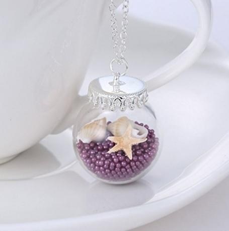 Bottiglia di vetro ciondolo con il mare