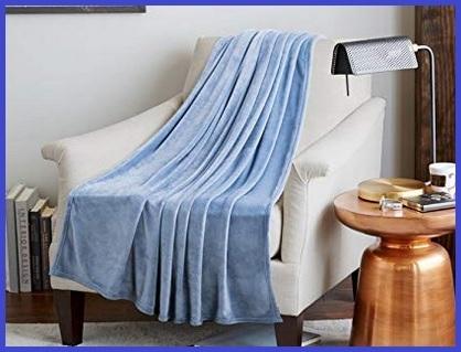 Coperta pile azzurra divano