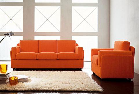 Divano tre posti e poltrona stoffa arancione lazio