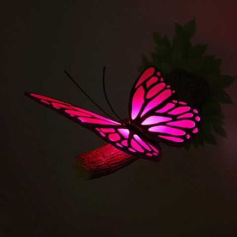 Lampada da muro con farfalla