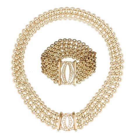 Parure cartier penelope double c in oro giallo e diamanti