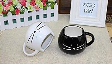 Due tazzine in ceramica a forma di gattino bianco e nero