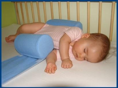 Cuscini posturali per il letto neonati